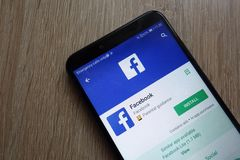 Facebook app on Google Play Store website displayed on a modern smartphone royalty free stock image