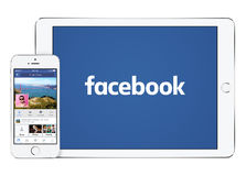 Facebook app on white Apple iPad Air 2 and iPhone 5s