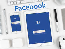 Facebook application on the iPhone and iPad display Stock Photos