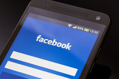 Facebook application on smart phone screen. stock image