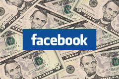 Facebook and cash money. Johor, Malaysia - Jan 1, 2014: Photo of Facebook icon and cash money. Marketers are starting to embrace the social network as a place to stock photos
