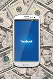 Facebook and cash money Royalty Free Stock Photo