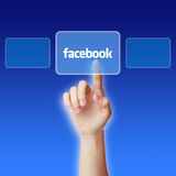 Facebook Concept. Hand press a button of facebook with blue gradually varied background Royalty Free Stock Photos
