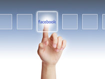 Facebook Concept. Hand press a button of facebook with gradually varied background Royalty Free Stock Image