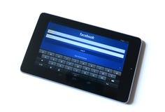 Facebook de la tableta Fotos de archivo libres de regalías