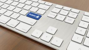 Facebook del teclado foto de archivo