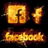 Facebook-Embleem op Brand Stock Foto