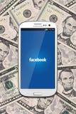 Facebook en contant geldgeld Royalty-vrije Stock Foto