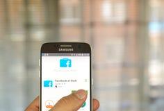 Facebook en el trabajo app Fotografía de archivo
