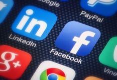 Facebook en smartphone Foto de archivo libre de regalías