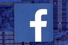 Facebook icon placed on circuit board royalty free stock photo