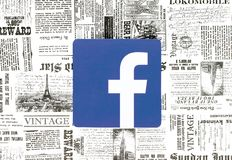 Facebook icon placed on retro newspaper background stock photos