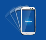 Facebook icon on smartphone Stock Photo
