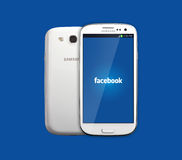 Facebook icon on smartphone Stock Photography