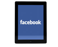 Facebook on iPad. The facebook logo on an iPad screen set against a white background Stock Photo