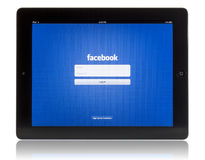 Facebook on iPad 3. The New iPad displaying login screen of Facebook application. Studio shot on white background Stock Photos