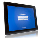 Facebook on iPad 3. The New iPad displaying login screen of Facebook application. Studio shot on white background Stock Photography