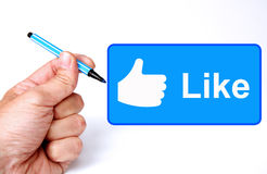 Facebook like. Drawing the Facebook Like sign Stock Photos