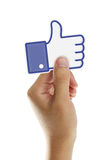 Facebook Like Button. Hand holding Facebook Like Button isolated on white background
