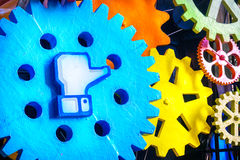 Facebook like. Cento, Italy, 19 feb 2017:  Facebook like symbol on a big gear. Facebook is a famous worldwide web social network Royalty Free Stock Photos
