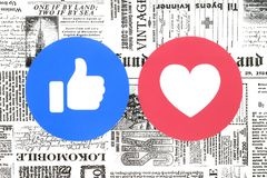 Facebook Like and Love buttons of Empathetic Emoji Reactions on newspaper stock illustration