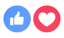 Facebook like and love icons. Kiev, Ukraine - May 27, 2017: Facebook like and love icons of Empathetic Emoji Reactions, printed on paper. Facebook is a well Stock Image
