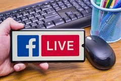 Facebook Live on mobile phone royalty free stock image