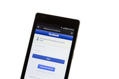 Facebook log-in on smart phone Stock Photos