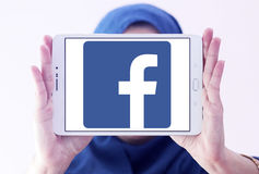 Facebook logo. Facebook application logo and vector on samsung tablet holded by arab muslim woman stock image