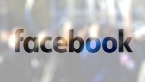 Facebook logo on a glass against blurred crowd on the steet. Editorial 3D rendering. Facebook logo on a glass against blurred crowd on the steet. Editorial 3D stock footage