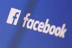 Facebook. The logo and inscription Facebook on the computer screen Royalty Free Stock Images