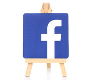 Facebook logo printed on paper and placed on wooden easel Stock Photo