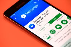 Facebook messenger application in Play Store stock photo