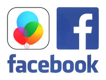 Facebook Moments logos printed on white paper. Kiev, Ukraine - July 11, 2016: Facebook Moments logos printed on white paper. Moments by Facebook is an easy way royalty free illustration