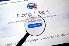 Facebook pages online page on PC screen. royalty free stock image