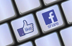 Facebook share and like icons on computer keyboard Stock Image