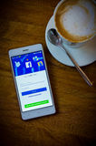 Facebook social media network on smart phone and coffee time Royalty Free Stock Images