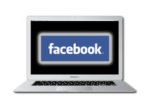 Facebook social network accessed on Macbook Pro Royalty Free Stock Photos