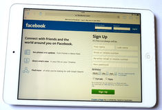 Facebook social network on ipad background white stock photography