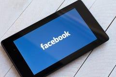 Facebook social network logo on tablet Royalty Free Stock Photos