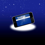 Facebook social network on mobile iphone 4S stock illustration
