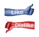 Facebook som motviljatumen upp tecken Arkivbild