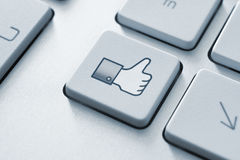 Facebook Thumb Up Like Button. Thumb up like button on the keyboard. Toned Image stock images