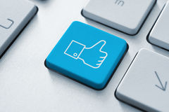Facebook Thumb Up Like Button. On the keyboard. Toned Image stock image