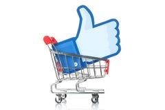 Facebook tummar upp tecken in i shoppingvagnen Royaltyfria Bilder