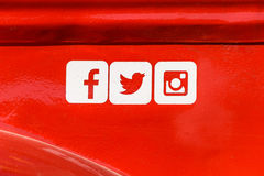 Facebook, Twitter and Instagram Social Media Icons on Red Metal Background Stock Photo