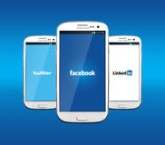 Facebook Twitter and Linkedin. Johor, Malaysia - Jan 1, 2014: Facebook, Twitter and Linkedin icon on smartphone screen. There are famous website in the world Royalty Free Stock Photos