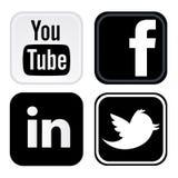 Facebook, Twitter, youtube, logo de linkedin a imprimé sur le livre blanc illustration stock