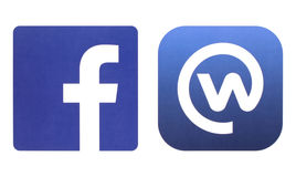 Facebook and Workplace logos printed on white paper Royalty Free Stock Image