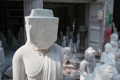 Faceless buddha marble statue Royalty Free Stock Photography